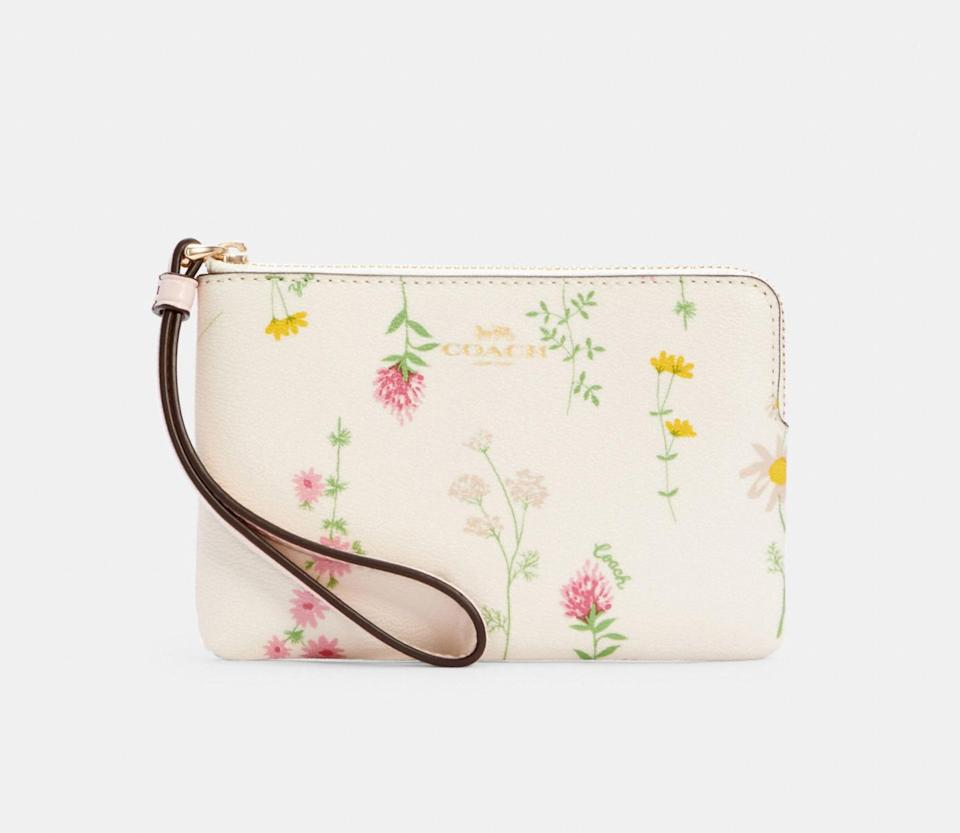 Corner Zip Wristlet With Spaced Wildflower Print. Image via Coach Outlet.