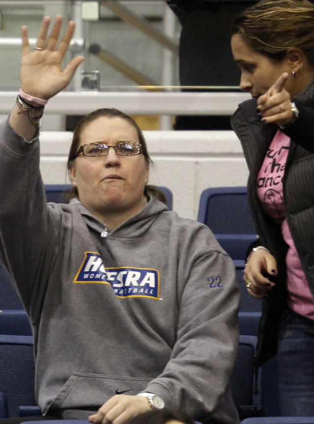 FILE - In this Feb. 16, 2012, file photo, Claire Droesch, left, waves to the crowd during Hofstra's NCAA college basketball loss to Delaware in Hempstead, N.Y. Former Boston College women's basketball star Droesch died on Friday, May 11, 2018, after a six-year battle with breast cancer the school announced. (AP Photo/Kathy Willens, File)