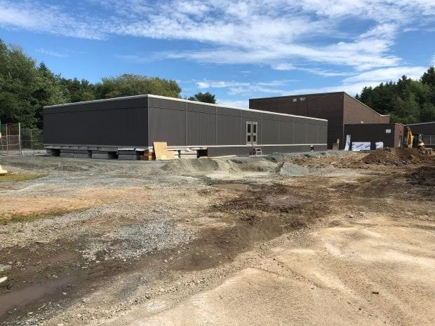 A modular classroom under construction at Duc d'Anville Elementary School in the Clayton Park neighbourhood of Halifax. (Paul Poirier/CBC - image credit)