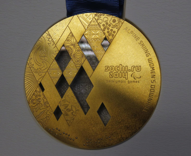 <p> A gold paralympic medal is displayed for journalists during a presentation of Sochi 2014 medals at the SportAccord International Convention in St.Petersburg, Russia, Thursday, May 30, 2013. (AP Photo/Dmitry Lovetsky)