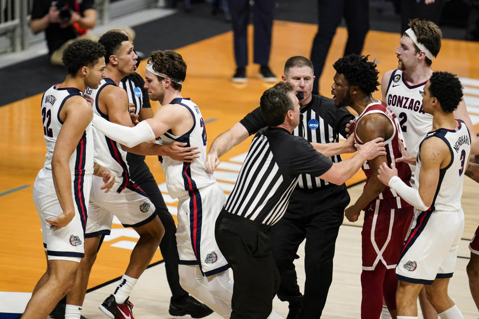 Oklahoma guard Elijah Harkless (24) is held by officials after a flagrant foul against Gonzaga in the second half of a second-round game in the NCAA men's college basketball tournament at Hinkle Fieldhouse in Indianapolis, Monday, March 22, 2021. Gonzaga defeated Oklahoma 87-71. (AP Photo/Michael Conroy)