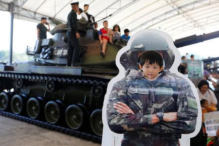 Children play during Children's Day celebration at a military facility in Bangkok, Thailand, January 13, 2018. REUTERS/Jorge Silva