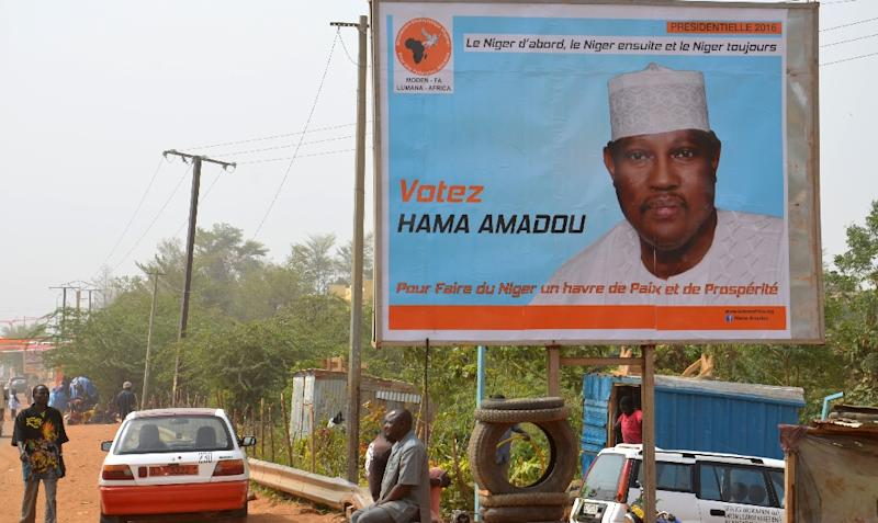 A campaign poster depicting Niger's leading opposition figure and contender Hama Amadou, jailed since November 2015 over his alleged involvement in a baby-trafficking scandal, on February 2, 2016