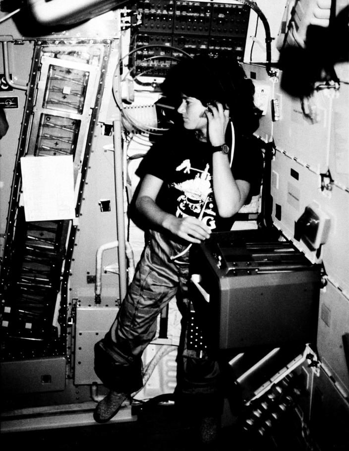 FILE - In this June 1983 file photo provided by NASA, astronaut Sally K. Ride, STS-7 mission specialist, communicates with ground controllers from the mid-deck of the earth-orbiting Space Shuttle Challenger. Ride, the first American woman in space, died Monday, July 23, 2012 after a 17-month battle with pancreatic cancer. She was 61. (AP Photo/NASA, File)