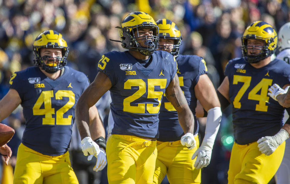 Michigan running back Hassan Haskins (25) celebrates his touchdown in the second quarter of an NCAA college football game against Michigan State in Ann Arbor, Mich., Saturday, Nov. 16, 2019. (AP Photo/Tony Ding)