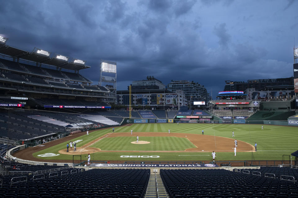Clouds move in during the fourth inning of an opening day baseball game between the Washington Nationals and the New York Yankees at Nationals Park, Thursday, July 23, 2020, in Washington. (AP Photo/Alex Brandon)