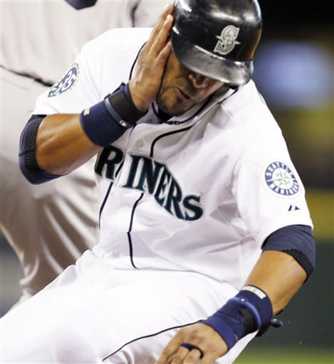 Seattle Mariners' Franklin Gutierrez tumbles to the ground after being hit on the side of his face by the ball in a pickoff-attempt at first base by Boston Red Sox pitcher Franklin Morales in the fourth inning of a baseball game on Thursday, June 28, 2012, in Seattle. Gutierrez left the game. (AP Photo/Elaine Thompson)