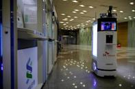 A self-driving robot sanitizes automated teller machines with UV light during its demonstration at the headquarters of SK Telecom in Seoul