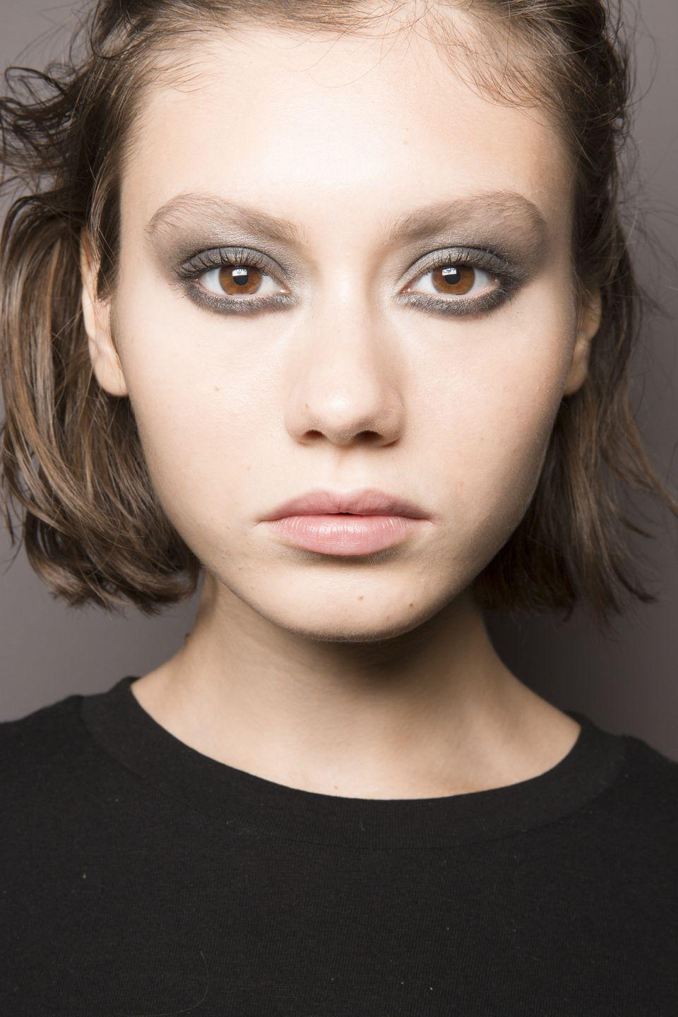 <p>Gunmetal smoky eyes with no other visible makeup was all that was needed backstage at Nicole Miller.</p>