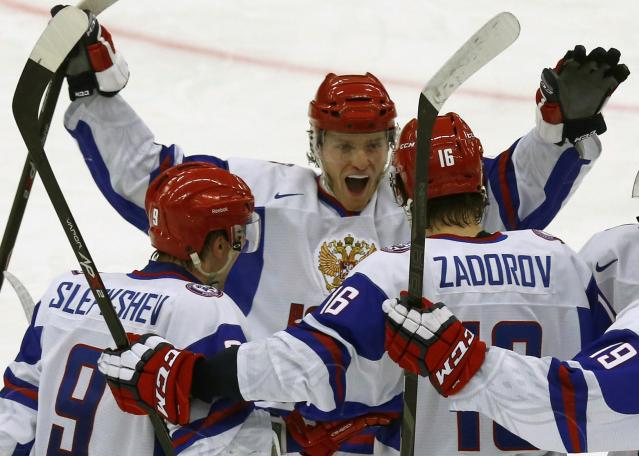 Russia's players Slepyshev, Mironov and Zadorov celebrate their goal against the U.S. in their IIHF Ice Hockey World Championship quarter-final match in Malmo