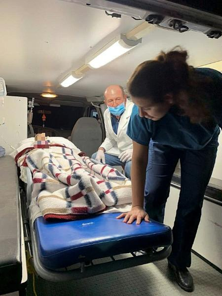 A picture released by the Health Secretary of Sonora state press office showing medical personnel transfering five members of the Lebaron family wounded in an ambush in Mexico (AFP Photo/HO)