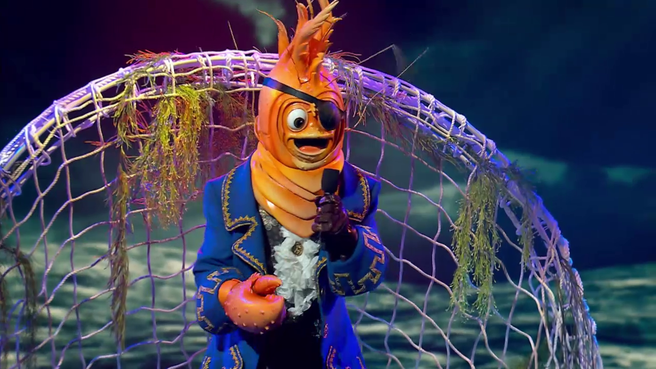 The Prawn in their costume performing on The Masked Singer Australia. Photo: Channel 10.