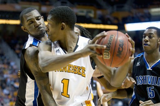UNC Asheville's Jeremy Atkinson defends Tennessee's Josh Richardson during an NCAA college basketball game at Thompson-Boling Arena on Tuesday, Dec. 20, 2011 in Knoxville, Tenn. (AP Photo/News Sentinel, Saul Young)