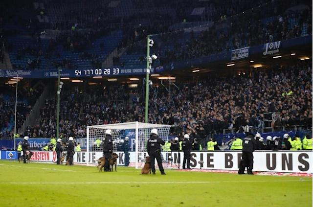 Police secure the pitch after a German first division football match in Hamburg, northern Germany