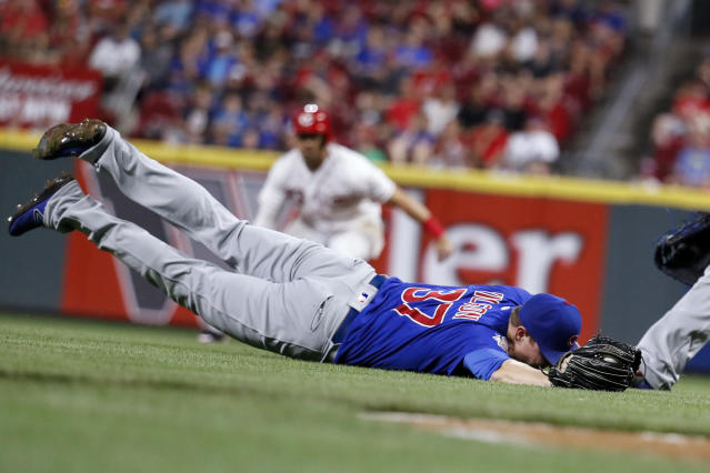 Chicago Cubs relief pitcher Justin Wilson catches a pop bunt by Cincinnati Reds' Jesse Winker during the seventh inning of a baseball game, Friday, June 22, 2018, in Cincinnati. The Reds won 6-3. (AP Photo/John Minchillo)