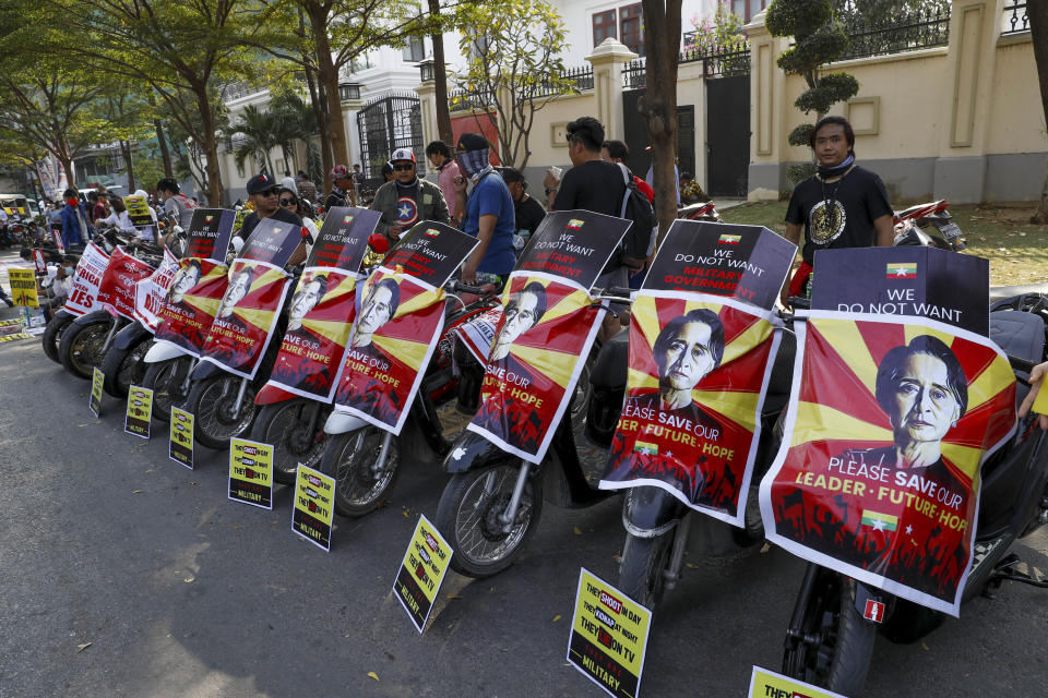 Soccer fans of Arsenal Football Club display placards against the military coup in their motor bikes in Mandalay, Myanmar on Thursday, Feb. 18, 2021. Demonstrators against Myanmar's military takeover returned to the streets Thursday after a night of armed intimidation by security forces in the country's second biggest city. (AP Photo)