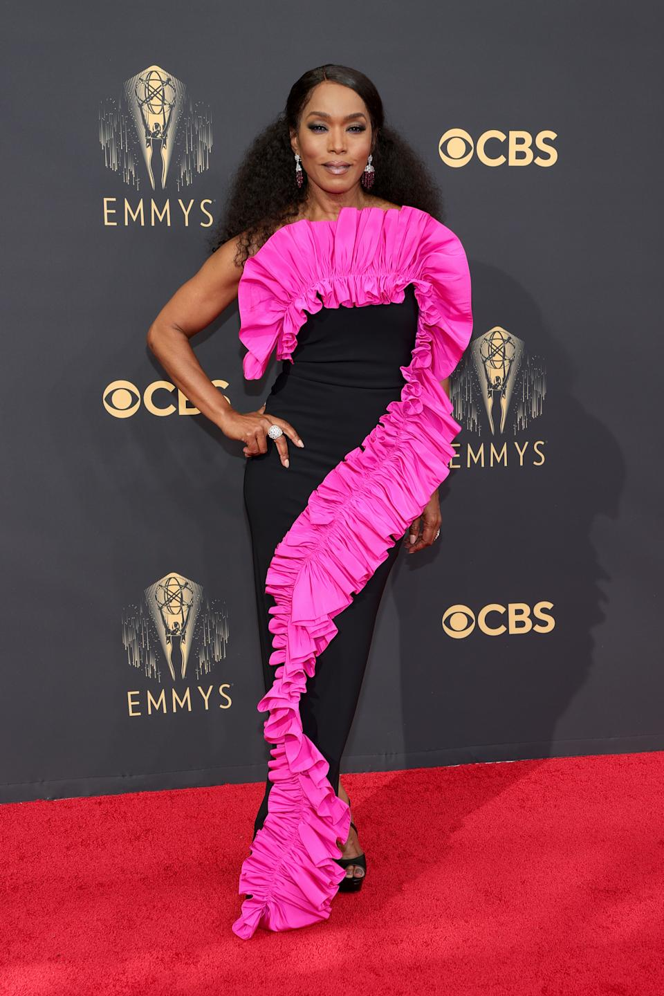 Angela Bassett wears a black strapless column dress with a pink ruffle at the 73rd Primetime Emmy Awards at L.A. LIVE on September 19, 2021 in Los Angeles, California. (Photo by Rich Fury/Getty Images)