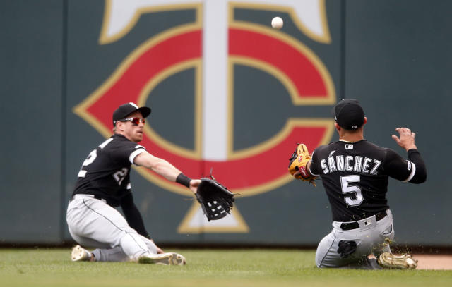 A double by Minnesota Twins' Jonathan Schoop drops between Chicago White Sox second baseman Yolmer Sanchez, right, and right fielder Charlie Tilson as they both tried to field it in the fourth inning of a baseball game Saturday, May 25, 2019, in Minneapolis. (AP Photo/Jim Mone)