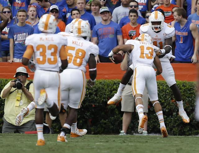 Tennessee's Devaun Swafford (13) celebrates with linebacker Dontavis Sapp (41) after returning an interception 62-yards for a touchdown during the first half of an NCAA college football game against Florida in Gainesville, Fla., Saturday, Sept. 21, 2013.(AP Photo/John Raoux)