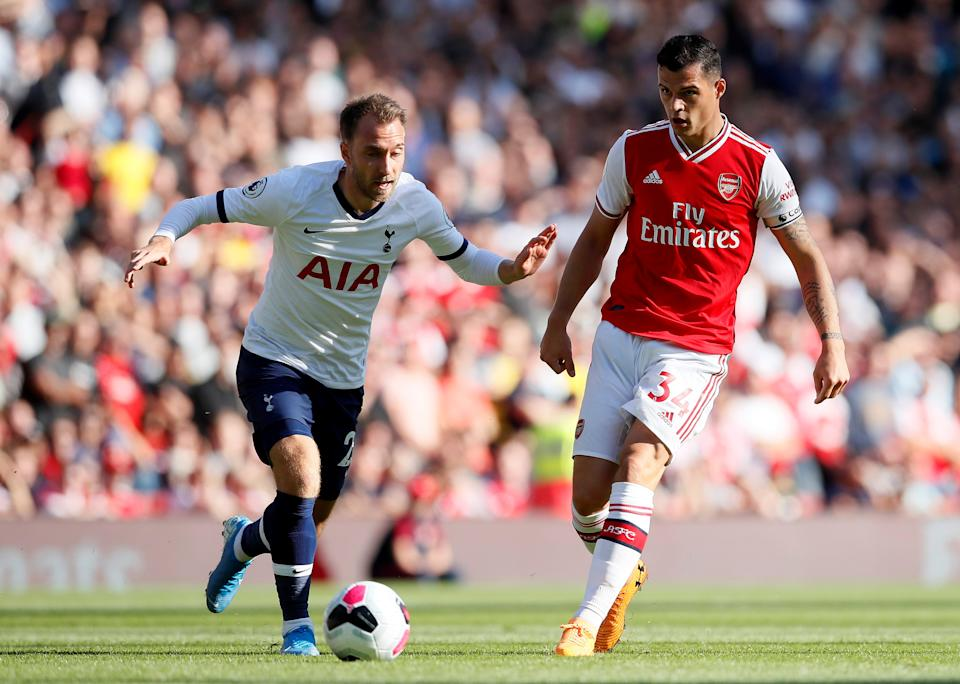 """Soccer Football - Premier League - Arsenal v Tottenham Hotspur - Emirates Stadium, London, Britain - September 1, 2019  Tottenham Hotspur's Christian Eriksen in action with Arsenal's Granit Xhaka   REUTERS/David Klein  EDITORIAL USE ONLY. No use with unauthorized audio, video, data, fixture lists, club/league logos or """"live"""" services. Online in-match use limited to 75 images, no video emulation. No use in betting, games or single club/league/player publications.  Please contact your account representative for further details."""