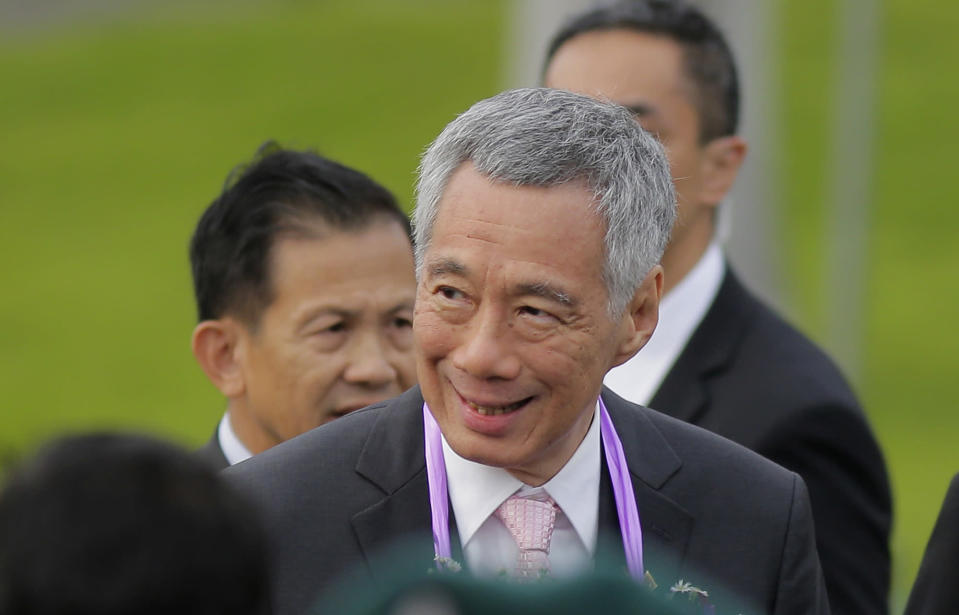 Singapore's Prime Minister Lee Hsien Loong, smiles upon his arrival in Colombo, Sri Lanka, in January. (PHOTO: Associated Press)