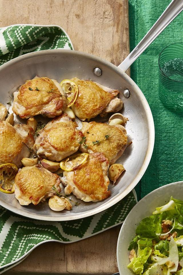 """<p>To get the skin on your chicken thighs to crisp up, place them in a heavy skillet, skin side down. Then place a second skillet on top of the chicken and put heavy cans inside to weigh it down. This flattens the chicken so it cooks evenly while giving it that extra-crispy crunch. </p><p><strong><a href=""""https://www.womansday.com/food-recipes/food-drinks/recipes/a60708/crispy-chicken-thighs-with-escarole-and-parmesan-salad-recipe/"""" target=""""_blank""""></a></strong><a></a><strong><a href=""""https://www.womansday.com/food-recipes/food-drinks/recipes/a60708/crispy-chicken-thighs-with-escarole-and-parmesan-salad-recipe/"""" target=""""_blank"""">Get the recipe.</a></strong> </p>"""