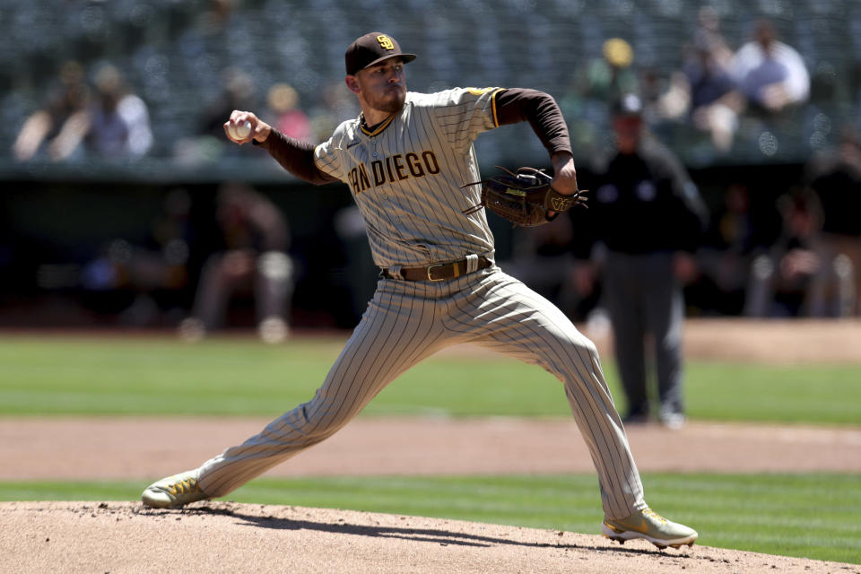 San Diego Padres' Joe Musgrove throws against the Oakland Athletics during the first inning of a baseball game in Oakland, Calif., Wednesday, Aug. 4, 2021. (AP Photo/Jed Jacobsohn)