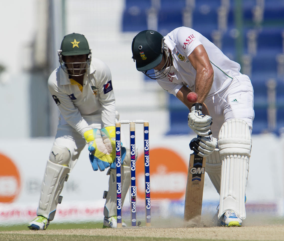 South Africa's Faf du Plessis bats as Pakistan's wicketkeeper Adnan Akmal bows during the fourth day of their first Test at the Sheikh Zayed Cricket Stadium in Abu Dhabi on October 17, 2013. AB de Villiers hit a fighting fifty to delay Pakistan's victory march over South Africa on the fourth day of the first Test in Abu Dhabi today. AFP PHOTO/STR        (Photo credit should read STR/AFP/Getty Images)