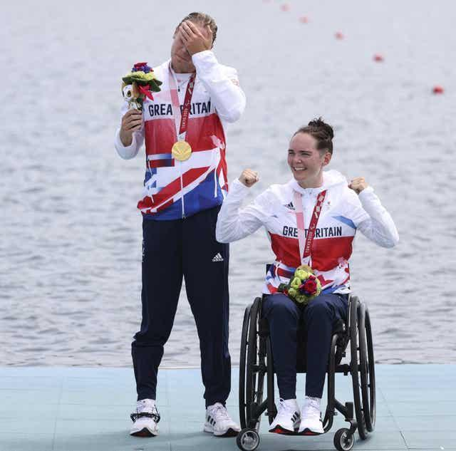 ParalympicsGB rowers Lauren Rowles and, Laurence Whiteley win gold in the PR2 mixed double sculls in Tokyo