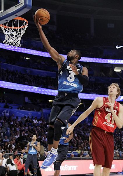 Eastern Conference's Dwyane Wade (3), of the Miami Heat, shoots a layup past Western Conference's Dirk Nowitzki (41), of the Dallas Mavericks, during the second half of the NBA All-Star basketball game, Sunday, Feb. 26, 2012, in Orlando, Fla. (AP Photo/Chris O'Meara)