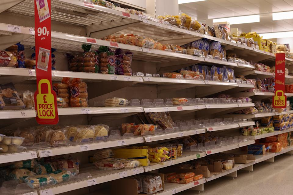 Photos of half empty shelves at supermarket in the UK.