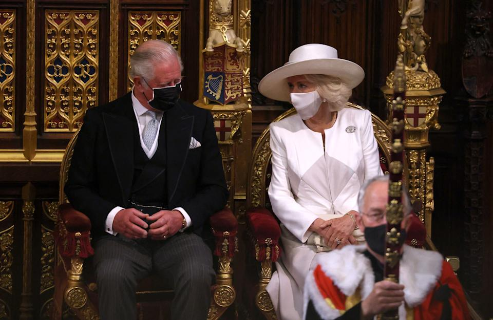 Britain's Prince Charles, Prince of Wales (L) and his wife Britain's Camilla, Duchess of Cornwall, both wearing face coverings, attend the State Opening of Parliament at the Houses of Parliament in London on May 11, 2021, which is taking place with a reduced capacity due to Covid-19 restrictions. - The State Opening of Parliament is where Queen Elizabeth II performs her ceremonial duty of informing parliament about the government's agenda for the coming year in a Queen's Speech. (Photo by Chris Jackson / POOL / AFP) (Photo by CHRIS JACKSON/POOL/AFP via Getty Images)