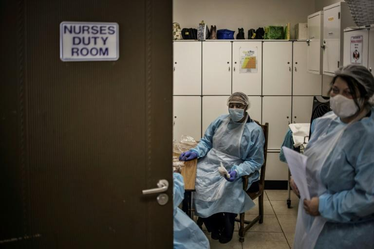 On the front line: More than 24,000 health workers in South Africa have been infected by coronavirus (AFP Photo/MARCO LONGARI)