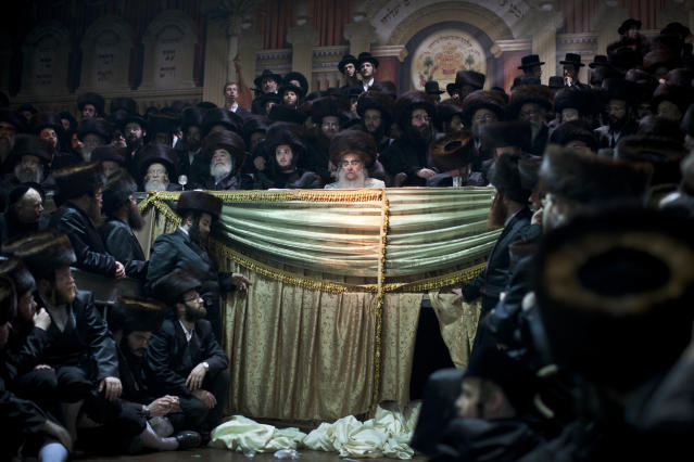 <p>Ultra-Orthodox Jews gather for the traditional Jewish wedding for Chananya Yom Tov Lipa, the great-grandson of the rabbi of the Wiznitz Hasidic followers, in the Israeli town of Petah Tikva near Tel Aviv, Israel, on Feb. 14, 2012. (Photo: Oded Balilty/AP) </p>