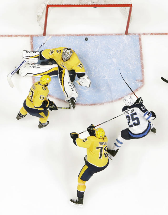 Winnipeg Jets center Paul Stastny (25) scores a goal against Nashville Predators goalie Pekka Rinne (35), of Finland, during the second period in Game 1 of an NHL hockey second-round playoff series Friday, April 27, 2018, in Nashville, Tenn. Predators' Nick Bonino (13) and P.K. Subban (76) also defend. (AP Photo/Mark Humphrey)