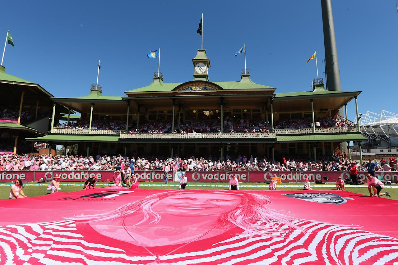 SYDNEY, AUSTRALIA - JANUARY 05:  A large banner is unveiled of Jane McGrath on Jane McGrath Pink Day during day three of the Third Test match between Australia and Sri Lanka at Sydney Cricket Ground on January 5, 2013 in Sydney, Australia.  (Photo by Cameron Spencer/Getty Images)
