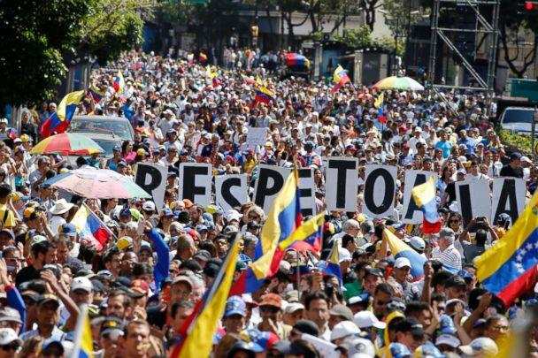 PHOTO: Hundreds of people march in Caracas, Venezuela, Feb. 12, 2019, in opposition to the government of President Maduro. (Ariana Cubillos/AP)