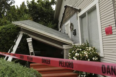 Red tape surrounds a home damaged by Sunday's magnitude 6.0 earthquake in Napa