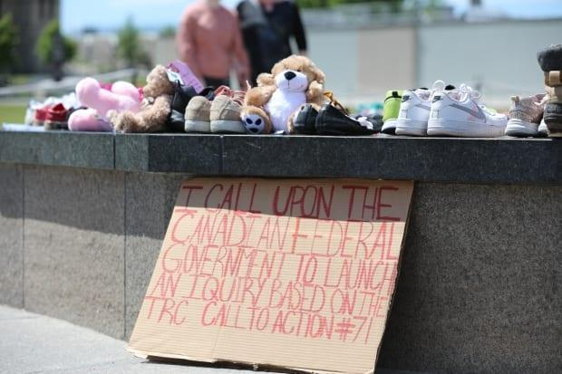 Visitors created a memorial at the Centennial Flame on Parliament Hill in Ottawa on May 30 honouring the memory of 215 children found buried at the site of a former residential school in Kamloops, B.C.