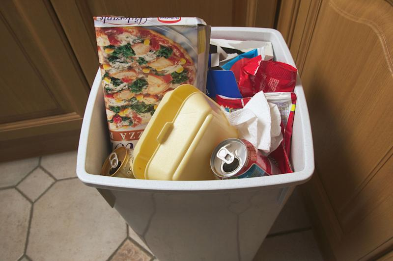 Cover the bottom of your kitchen bin with old newspaper or sprinkle a few teaspoons of baking soda to soak up leaks and odours.