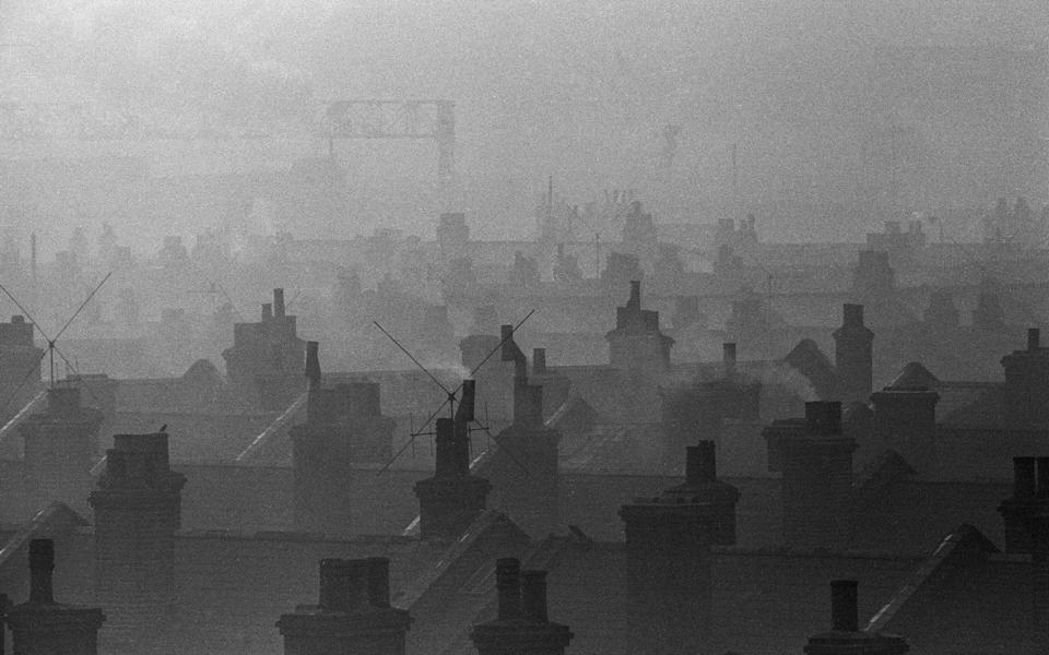 Smog caused by coal fires hangs over the roof tops of Battersea, London, 7th December 1962. (Photo by Ron Burton/Mirrorpix/Getty Images) - Getty