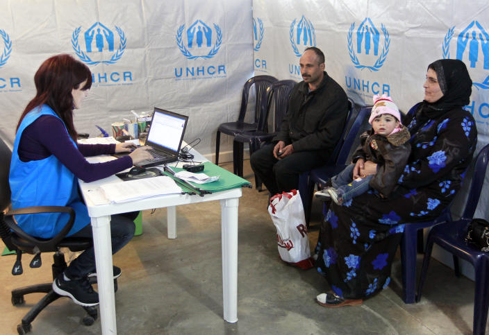 "A Syrian family who fled their home from Aleppo register, at the UNHCR center in the northern city of Tripoli, Lebanon, Wednesday, March. 6, 2013. The number of Syrians who have fled their war-ravaged country and are seeking assistance has now topped the one million mark, the United Nations' refugee agency said Wednesday warning that Syria is heading towards a ""full-scale disaster."" (AP Photo/Bilal Hussein)"