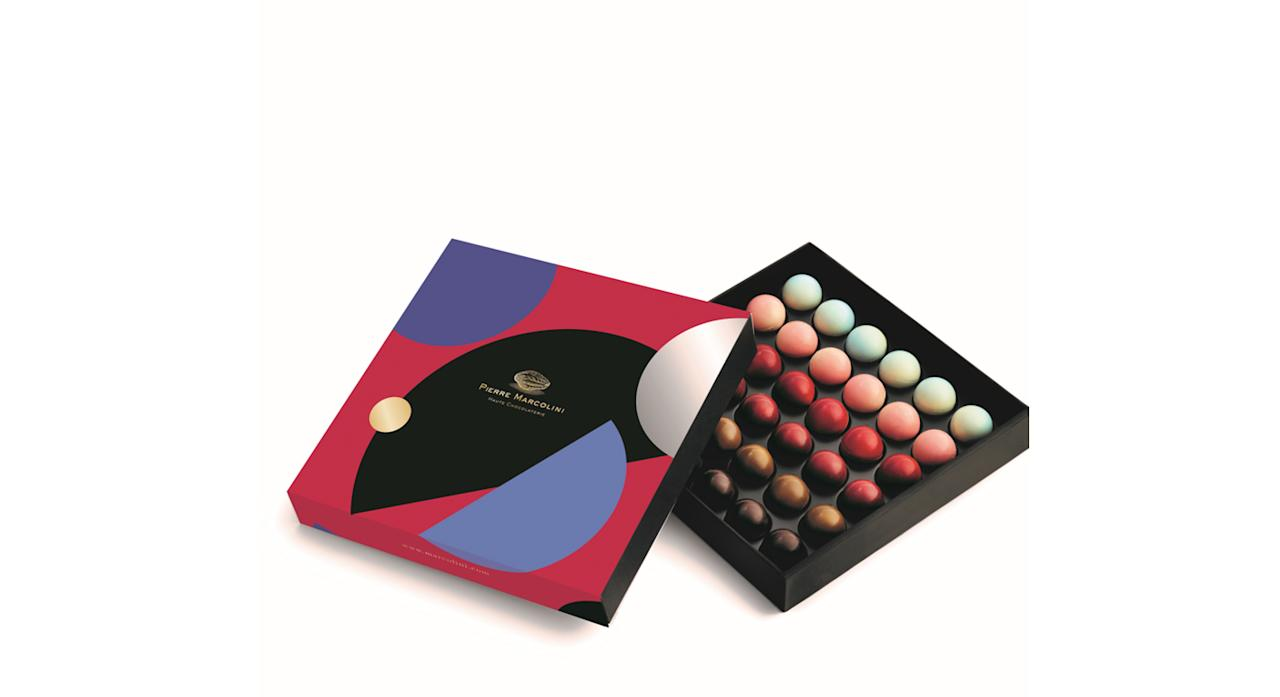 "<p><a rel=""nofollow"" href=""https://uk.marcolini.com/chocolate-box-of-36-planets.html""><em>Pierre Marcolini, £39</em></a> </p>"