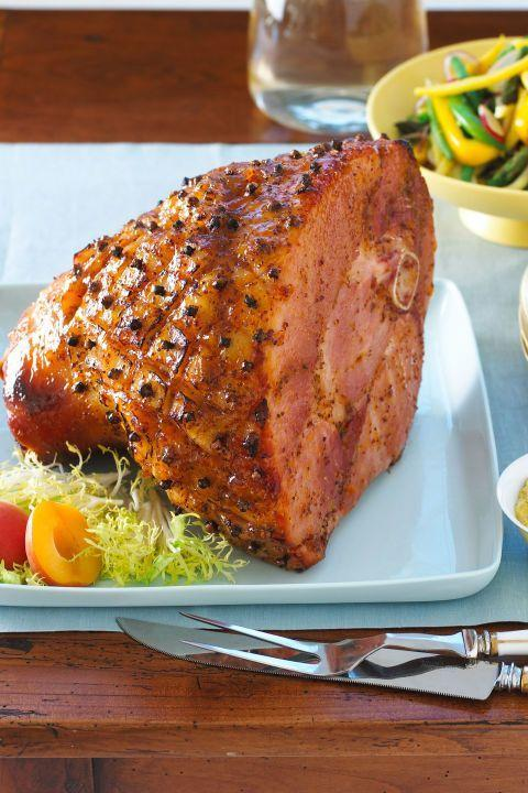 """<p>This year, mix things up with a flavorful glaze and seasonings that will take your ham from ordinary to extraordinary.<br></p><p><em><a href=""""http://www.womansday.com/food-recipes/food-drinks/recipes/a10740/apricot-glazed-smoked-ham-122074/"""" rel=""""nofollow noopener"""" target=""""_blank"""" data-ylk=""""slk:Get the recipe on Woman's Day »"""" class=""""link rapid-noclick-resp"""">Get the recipe on Woman's Day »</a></em></p>"""