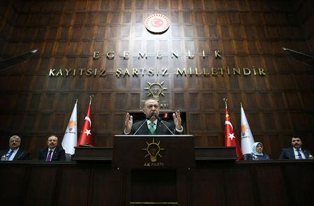Turkish President Tayyip Erdogan addresses members of parliament from his ruling AK Party during a meeting in Ankara