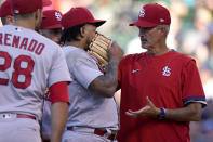 St. Louis Cardinals pitching coach Mike Maddux, right, talks to starting pitcher Carlos Martinez during the third inning of a baseball game against the Chicago Cubs in Chicago, Sunday, June 13, 2021. (AP Photo/Nam Y. Huh)