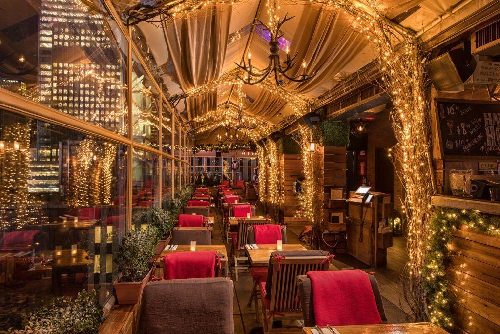 """<p>There are plenty of places to get in the holiday spirit that don't involve getting shoved by tourists (ahem, Rockefeller Center tree and the lights show at Saks). Our favorite interpretation of the phrase is quite literal— actually <a href=""""https://www.delish.com/holiday-recipes/christmas/g860/holiday-cocktails/"""">downing our favorite spirits</a> at <a href=""""https://www.delish.com/entertaining/g27421455/best-rooftop-bars-nyc/"""">festive bars across the city</a> far away from anyone who might say, """"Let's go to FAO Schwarz!"""" So, grab some friends and start celebrating the most wonderful time of the year accordingly.</p>"""