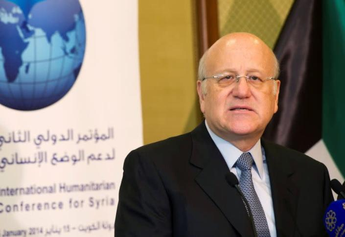 FILE PHOTO: Lebanon's caretaker Prime Minister Mikati attends a news conference at the opening session of the Syrian Donors Conference in Kuwait City