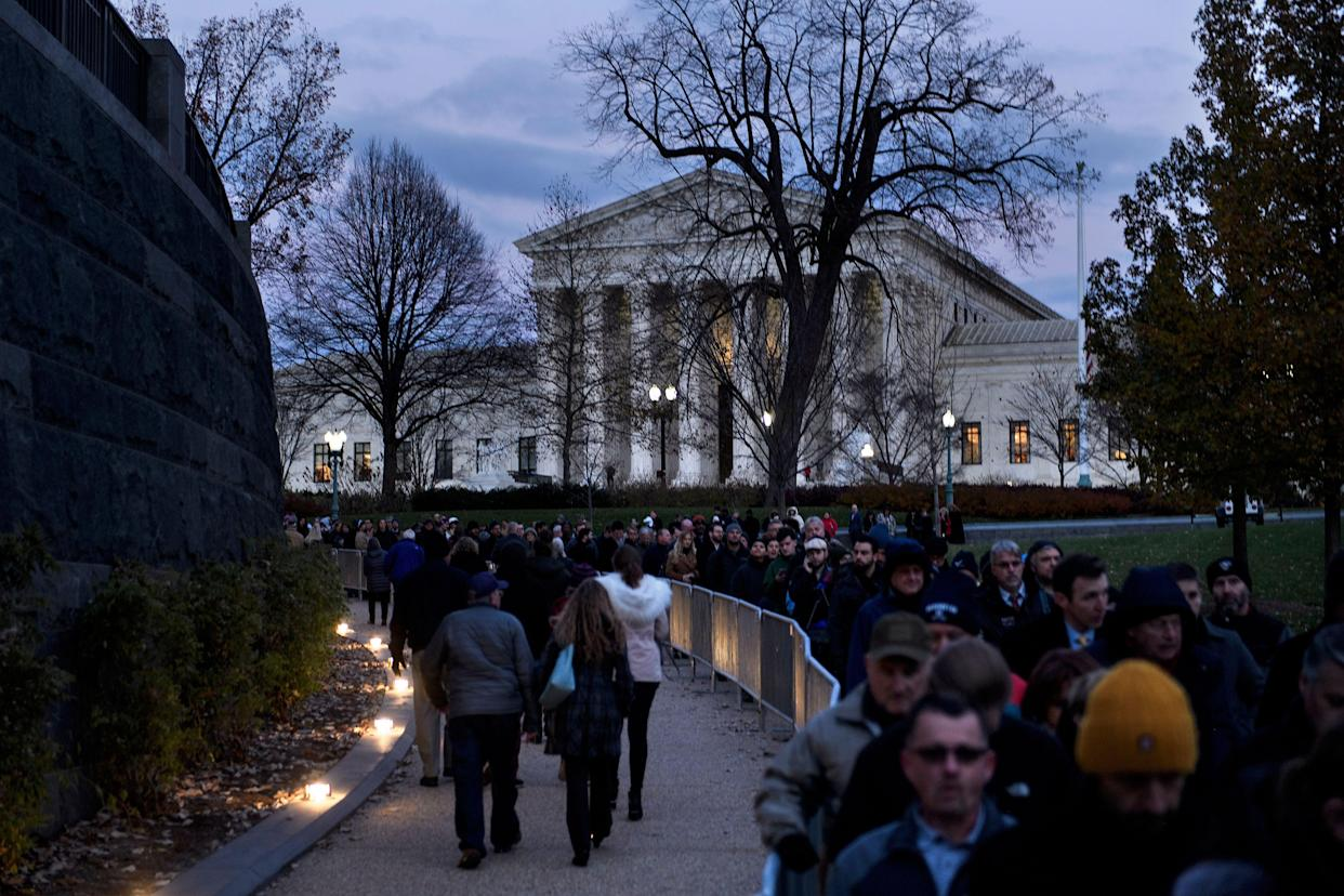 People wait in line to pay respects as the remains of former President George H. W. Bush lie in state in the U,S, Capitol's rotunda, Dec. 4, 2018 in Washington, D.C. (Photo: Brendan Smialowski/AFP/Getty Images)