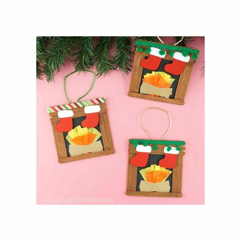 """<p>Stain craft sticks, then glue them together into a square shape. Let each family member craft their own holiday mantle. </p><p><em>Get the tutorial at <a href=""""https://iheartcraftythings.com/fireplace-craft.html"""" rel=""""nofollow noopener"""" target=""""_blank"""" data-ylk=""""slk:I Heart Crafty Things"""" class=""""link rapid-noclick-resp"""">I Heart Crafty Things</a>.</em></p><p><a class=""""link rapid-noclick-resp"""" href=""""https://www.amazon.com/Tachibelle-Premium-Building-Creating-Projects/dp/B082BK1366/?tag=syn-yahoo-20&ascsubtag=%5Bartid%7C10072.g.34443405%5Bsrc%7Cyahoo-us"""" rel=""""nofollow noopener"""" target=""""_blank"""" data-ylk=""""slk:SHOP CRAFT STICKS"""">SHOP CRAFT STICKS</a></p>"""